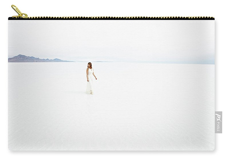 Scenics Carry-all Pouch featuring the photograph Woman Wearing Dress Walking Through by Thomas Barwick