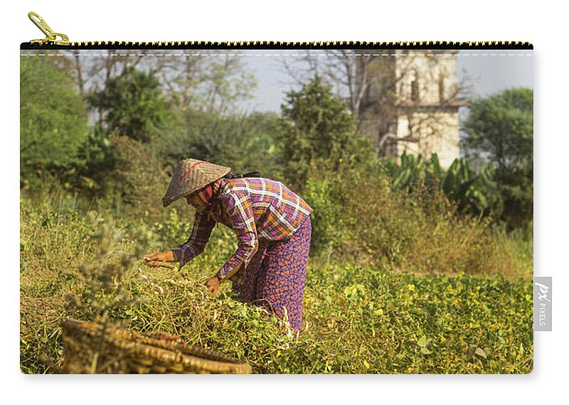 Three Quarter Length Carry-all Pouch featuring the photograph Woman Weeding At Nanmyin Tower by Merten Snijders
