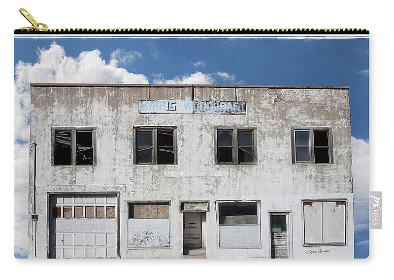 Woodgate Building Carry-all Pouch featuring the photograph Woodgate Building by Sylvia Thornton