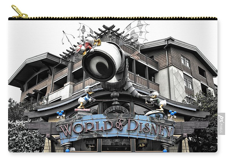 Disney Carry-all Pouch featuring the photograph World Of Disney Signage Downtown Disneyland Sc by Thomas Woolworth