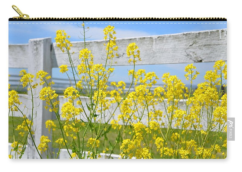 Yellow Carry-all Pouch featuring the photograph Yellow Flowers And A White Fence by Bill Cannon