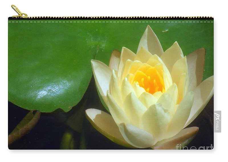 Yellow Carry-all Pouch featuring the photograph Yellow Lily by Jennifer Lavigne