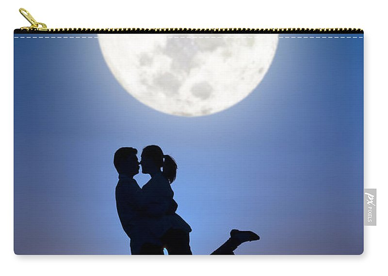 Couple Carry-all Pouch featuring the photograph Young Lovers Embracing Before A Full Moon by Lee Avison