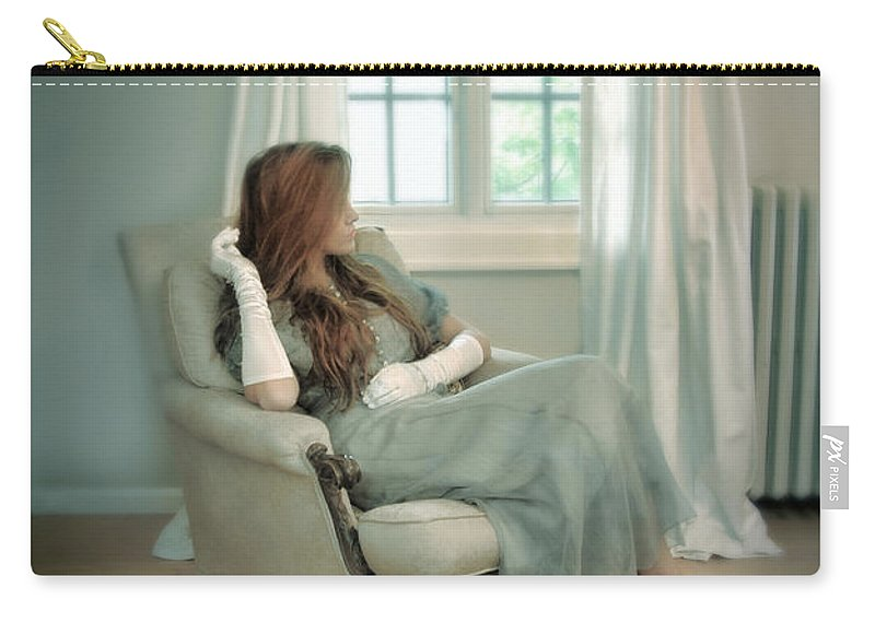 Woman Carry-all Pouch featuring the photograph Young Woman In A Chair by Jill Battaglia