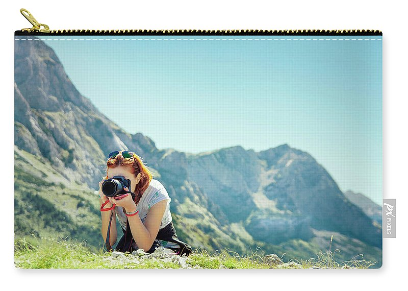 Travel Destinations Carry-all Pouch featuring the photograph Young Woman Photographing In Mountains by Marko Radovanovic