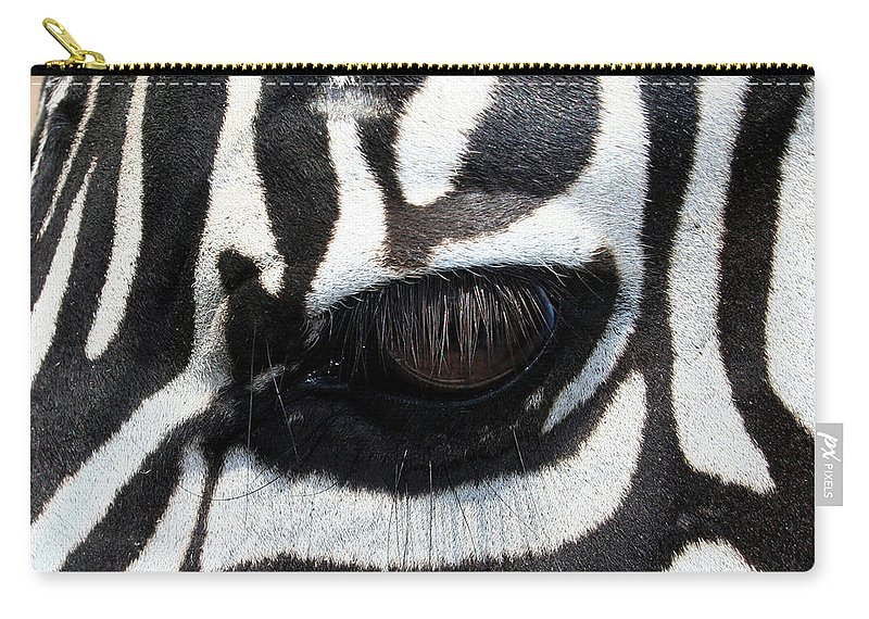 Zebra Carry-all Pouch featuring the photograph Zebra Eye by Linda Sannuti