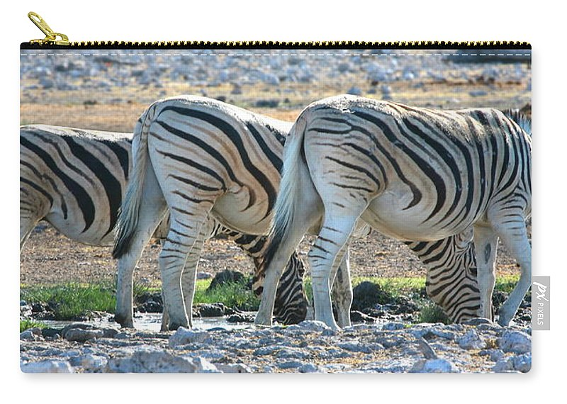 Zebra Carry-all Pouch featuring the photograph Zebra Lineup by Bruce J Robinson