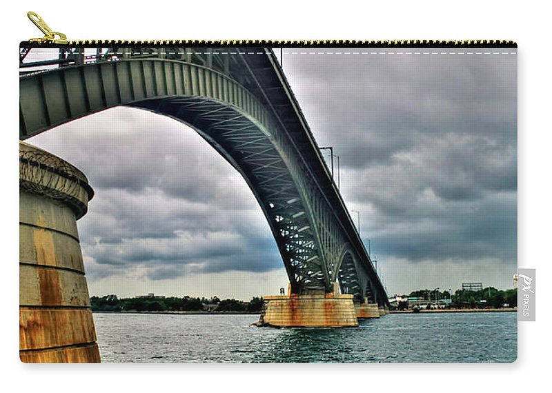 Carry-all Pouch featuring the photograph 009 Stormy Skies Peace Bridge Series by Michael Frank Jr