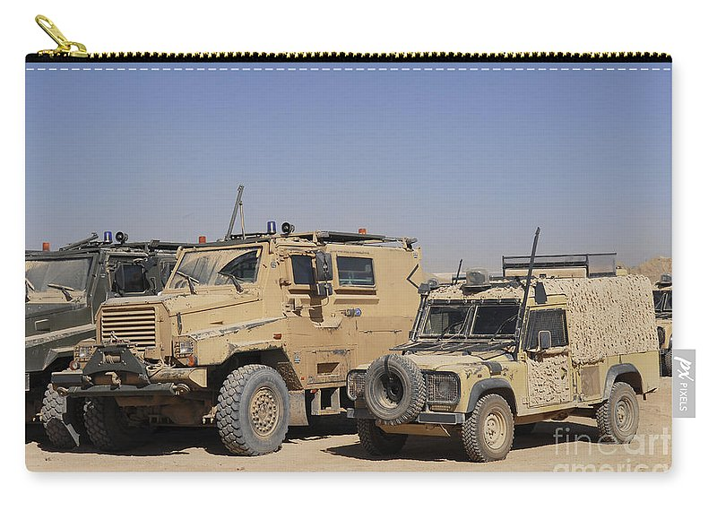 4x4 Carry-all Pouch featuring the photograph A British Armed Forces Snatch Land by Andrew Chittock