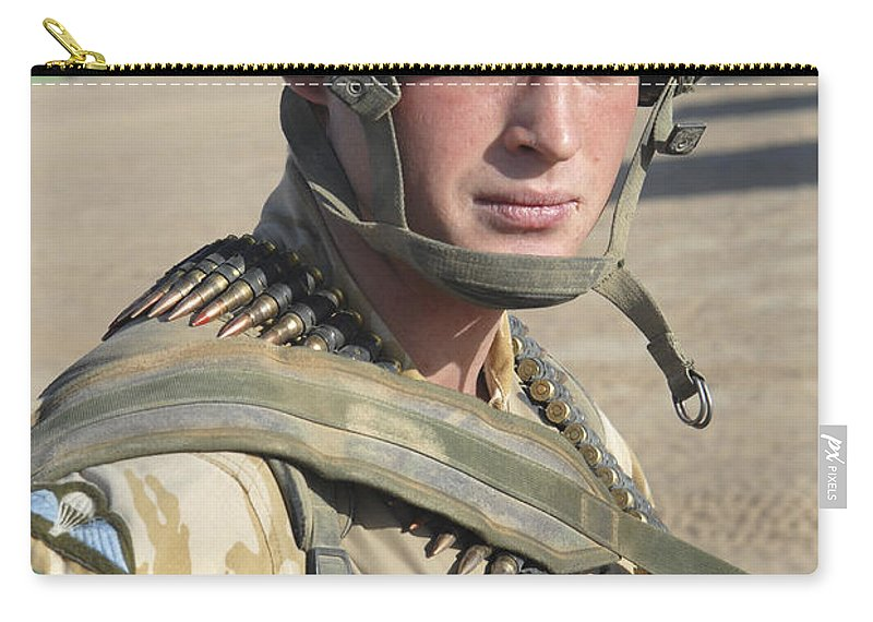 Foreign Military Carry-all Pouch featuring the photograph A British Army Soldier Provides by Andrew Chittock