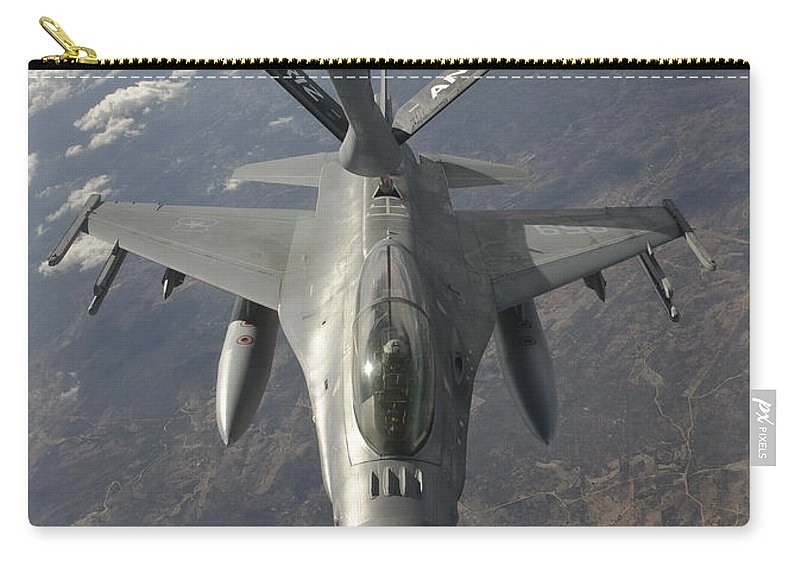 Transportation Carry-all Pouch featuring the photograph A Chilean Air Force F-16 Refuels by Giovanni Colla