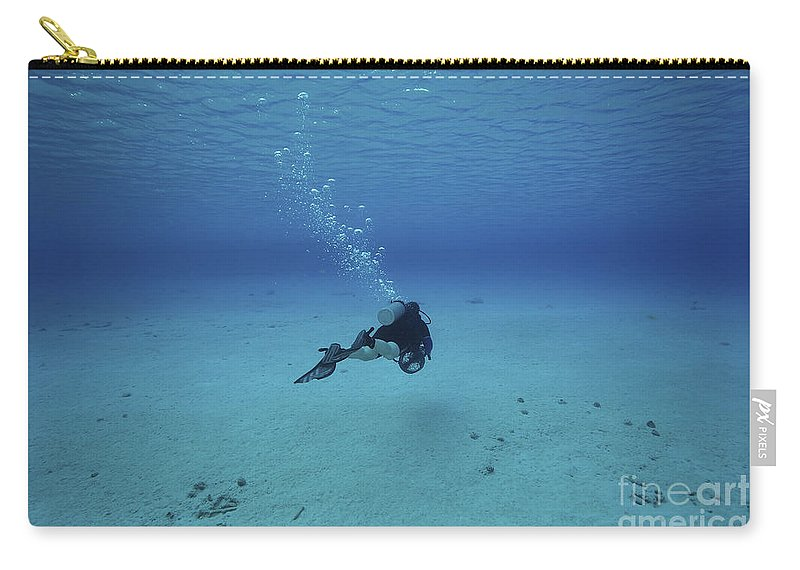 Scooter Carry-all Pouch featuring the photograph A Diver On A Scooter Explores The Clear by Terry Moore