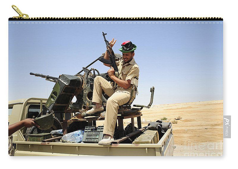 Ajadabiya Carry-all Pouch featuring the photograph A Free Libyan Army Pickup Truck by Andrew Chittock