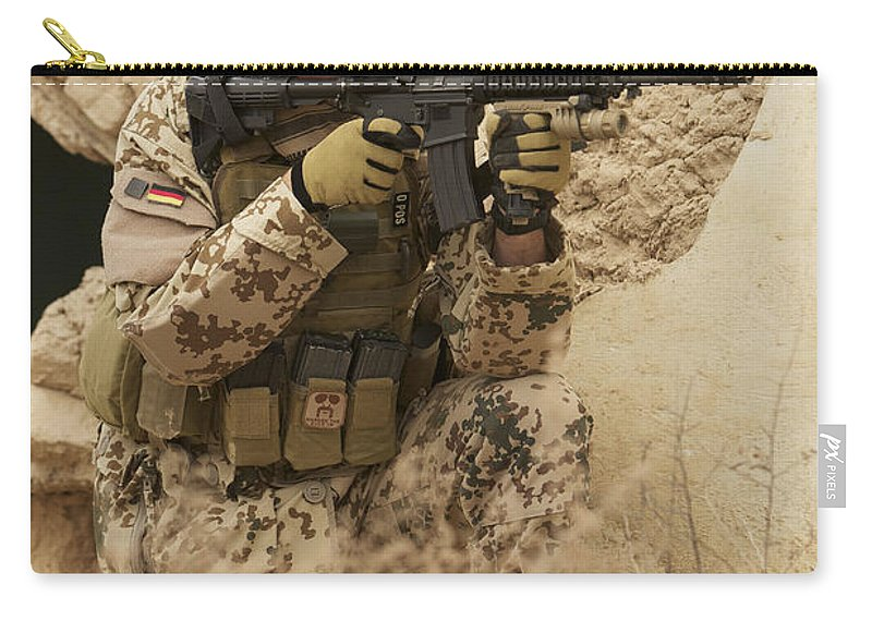 Looking Through Carry-all Pouch featuring the photograph A German Army Soldier Armed With A M4 by Terry Moore