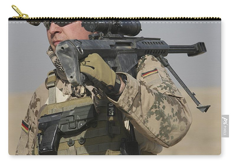 Weapon Carry-all Pouch featuring the photograph A German Soldier Carries A Barrett by Terry Moore