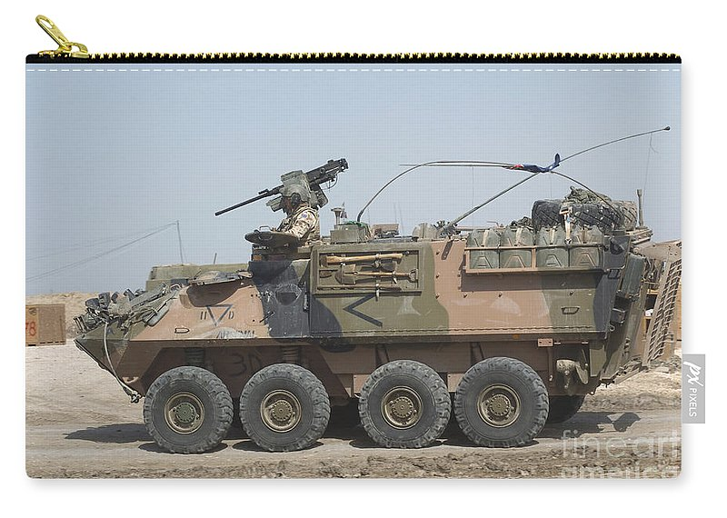 Light Armored Vehicles Carry-all Pouch featuring the photograph A Lav IIi Infantry Fighting Vehicle by Andrew Chittock