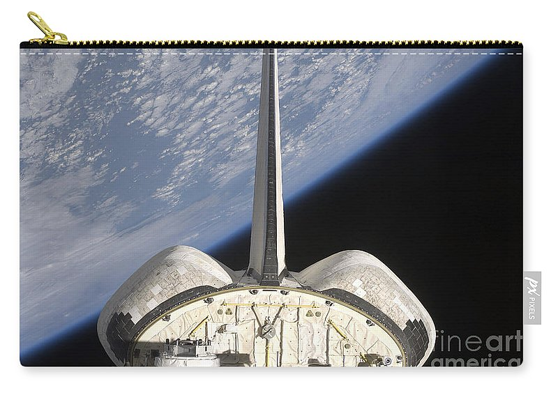 Sts-127 Carry-all Pouch featuring the photograph A Partial View Of Space Shuttle by Stocktrek Images