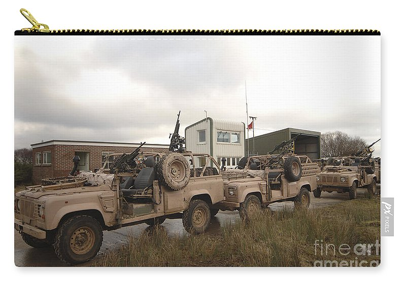 Foreign Military Carry-all Pouch featuring the photograph A Pink Panther Land Rover by Andrew Chittock