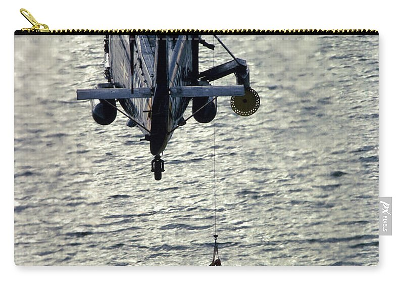 Vertical Carry-all Pouch featuring the photograph A Search And Rescue Swimmer Is Hoisted by Stocktrek Images