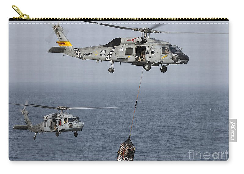 Arabian Sea Carry-all Pouch featuring the photograph A Sh-60j Seahawk Transfers Cargo by Gert Kromhout