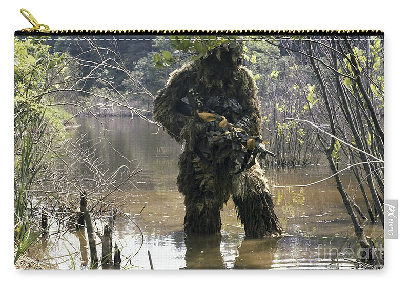 Three Quarter Length Carry-all Pouch featuring the photograph A Sniper Dressed In A Ghillie Suit by Stocktrek Images