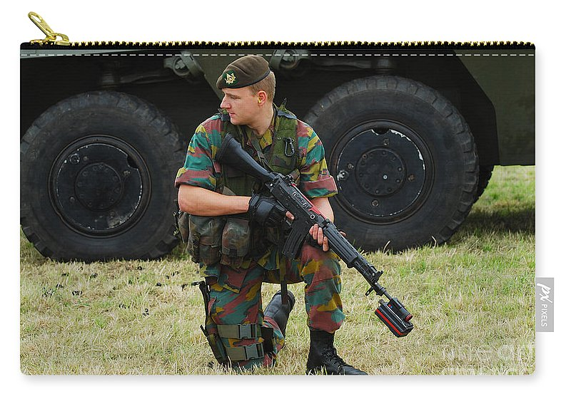 5.56mm Carry-all Pouch featuring the photograph A Soldier Of An Infantry Unit by Luc De Jaeger