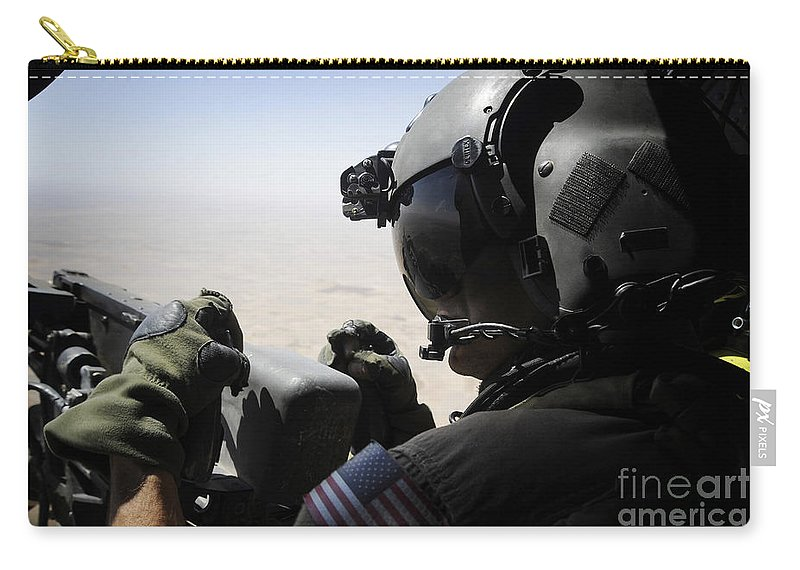 Aerial Gunner Carry-all Pouch featuring the photograph A Soldier Provides Security by Stocktrek Images