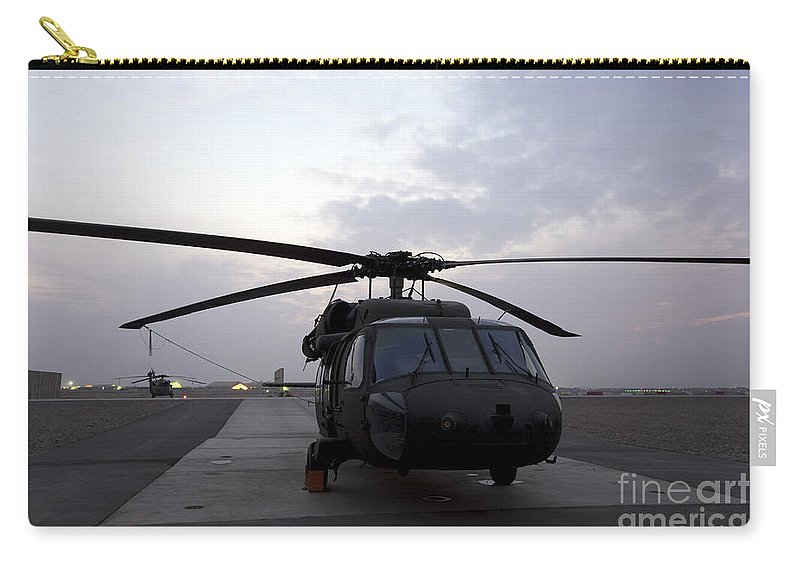 Aviation Carry-all Pouch featuring the photograph A Uh-60 Black Hawk Helicopter by Terry Moore