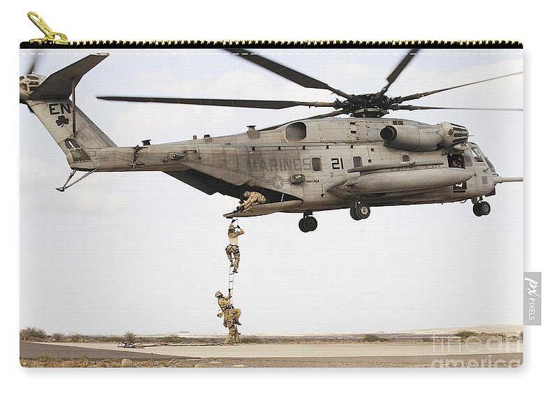 Africom Carry-all Pouch featuring the photograph Air Force Pararescuemen Conduct by Stocktrek Images