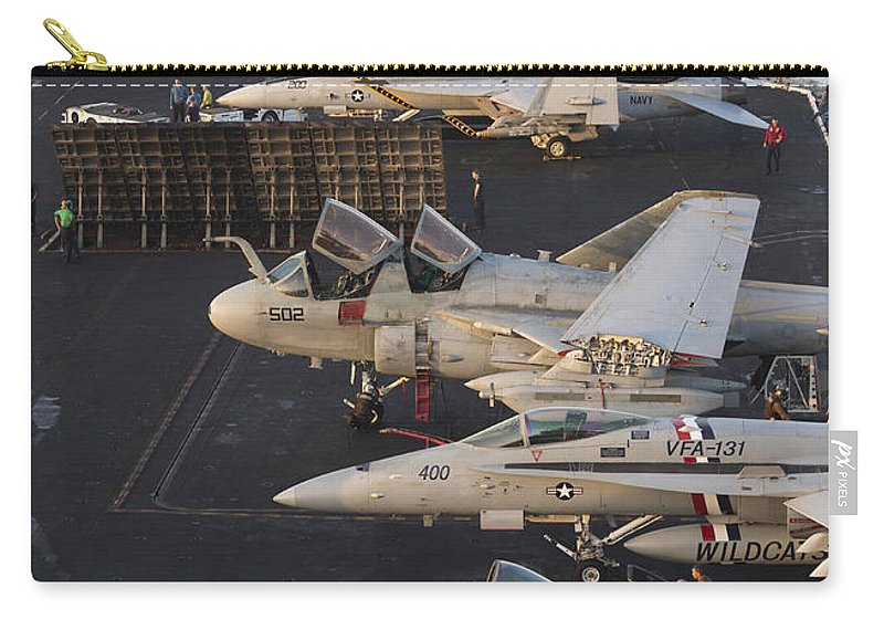 Arabian Sea Carry-all Pouch featuring the photograph Aircraft Parked On The Flight Deck by Gert Kromhout