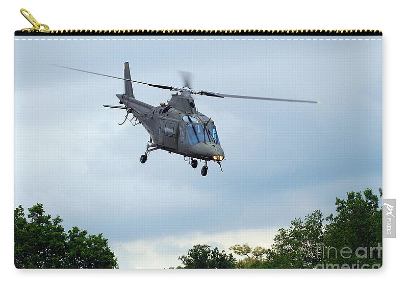 Helicopter Carry-all Pouch featuring the photograph An Agusta A109 Helicopter by Luc De Jaeger