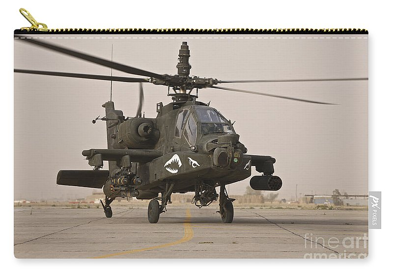 Ah-64 Carry-all Pouch featuring the photograph An Ah-64 Apache Helicopter Taxiing by Terry Moore