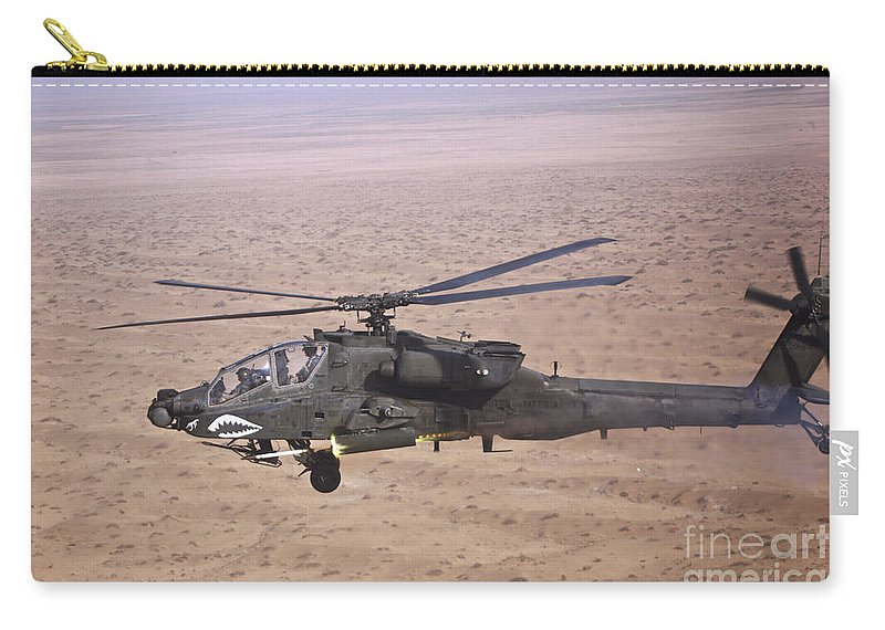 Ah-64 Carry-all Pouch featuring the photograph An Ah-64d Apache Longbow Fires A Hydra by Terry Moore