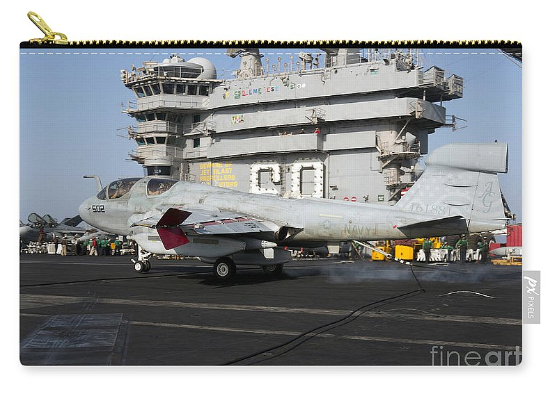 Arabian Sea Carry-all Pouch featuring the photograph An Ea-6b Prowler Makes An Arrested by Gert Kromhout