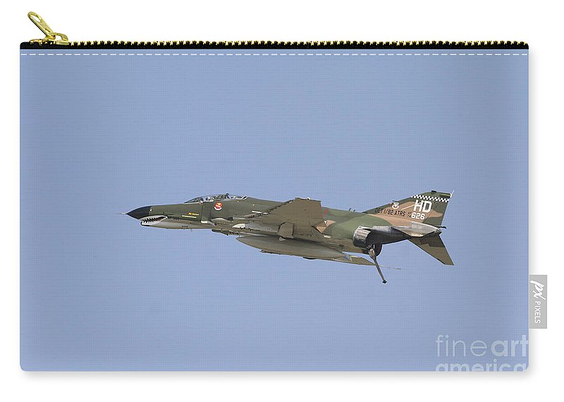 Horizontal Carry-all Pouch featuring the photograph An F-4 Phantom In Flight Over Houston by Terry Moore