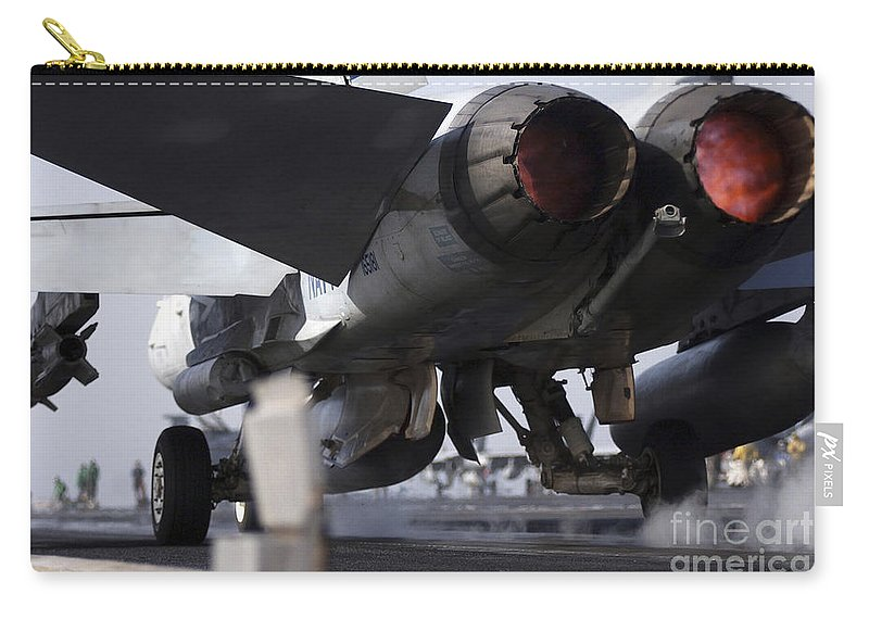 Horizontal Carry-all Pouch featuring the photograph An Fa-18c Hornet Launches by Stocktrek Images