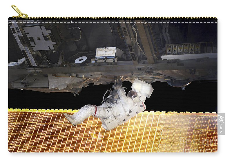 Adults Only Carry-all Pouch featuring the photograph Astronaut Participates In A Spacewalk by Stocktrek Images