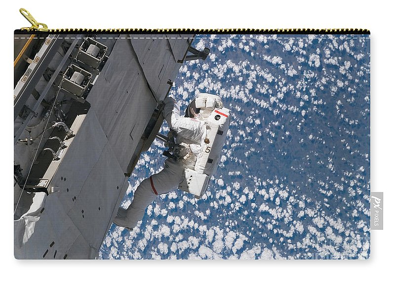 Adults Only Carry-all Pouch featuring the photograph Astronaut Traverses by Stocktrek Images