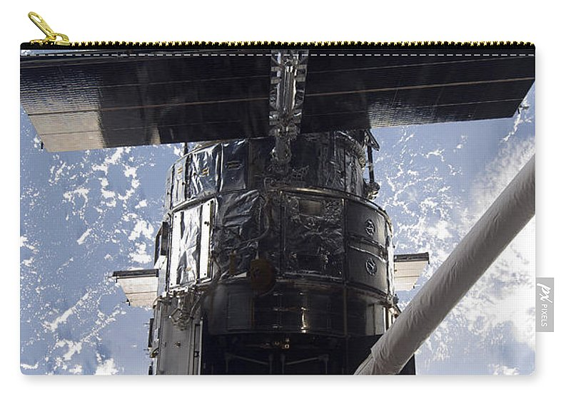 Artificial Satellites Carry-all Pouch featuring the photograph Astronaut Working On The Hubble Space by Stocktrek Images