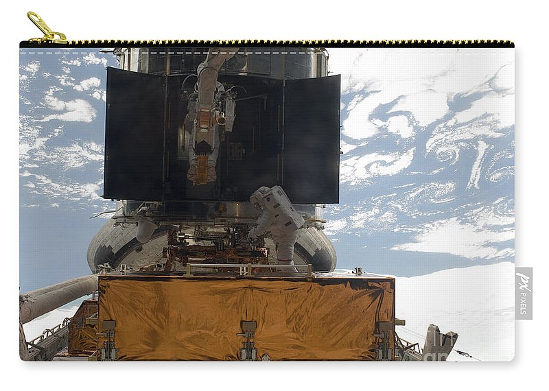 Outer Space Carry-all Pouch featuring the photograph Astronauts Working On The Hubble Space by Stocktrek Images