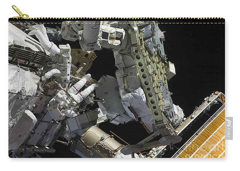 Sts-127 Carry-all Pouch featuring the photograph Astronauts Working On The International by Stocktrek Images