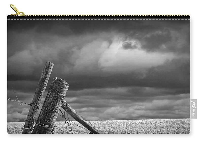 Art Carry-all Pouch featuring the photograph Canola Field In Southern Alberta by Randall Nyhof