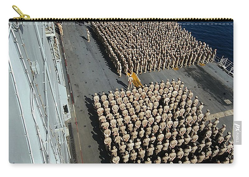 Color Image Carry-all Pouch featuring the photograph Crew Aboard The Amphibious Assault Ship by Stocktrek Images