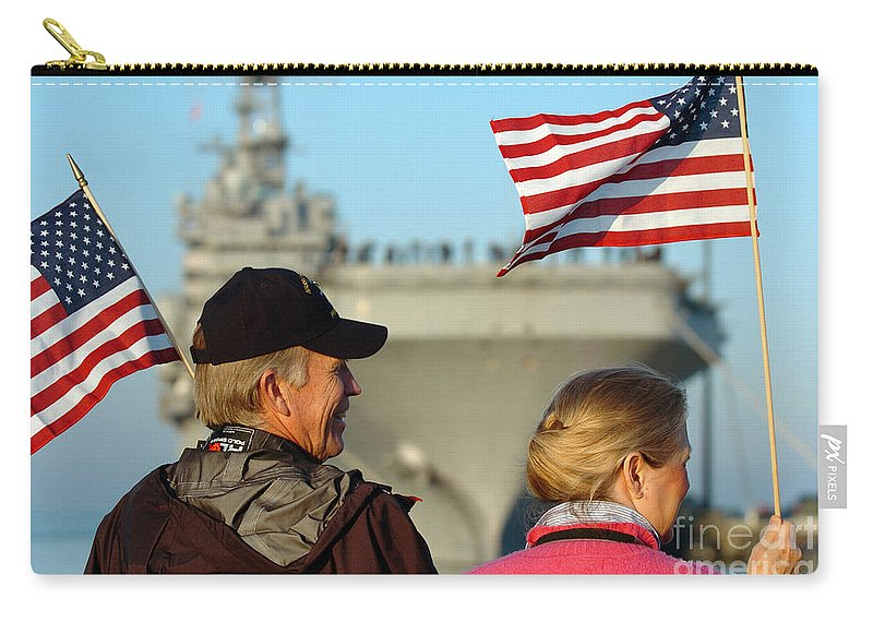 Horizontal Carry-all Pouch featuring the photograph Family Members Wave Flags To Show by Stocktrek Images