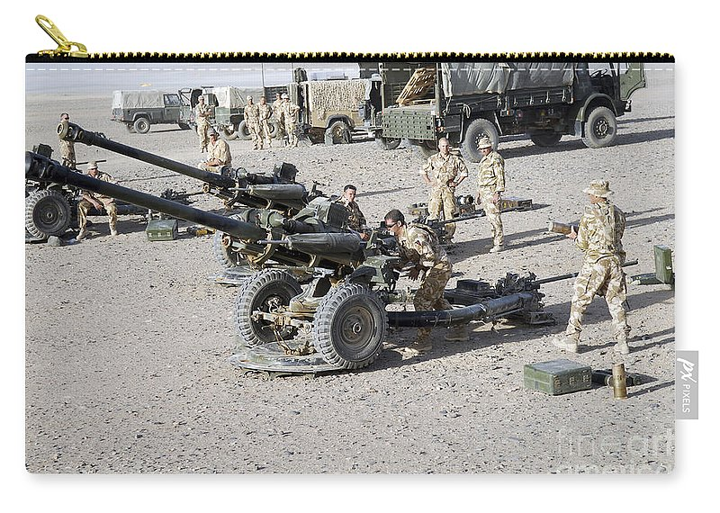 Armament Carry-all Pouch featuring the photograph Howitzer 105mm Light Guns Are Lined by Andrew Chittock