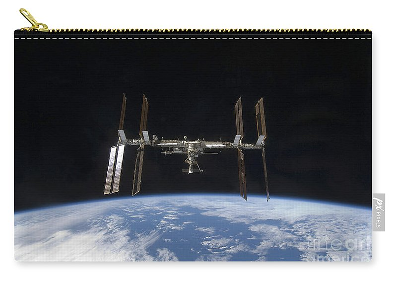 Sts-128 Carry-all Pouch featuring the photograph International Space Station Backdropped by Stocktrek Images