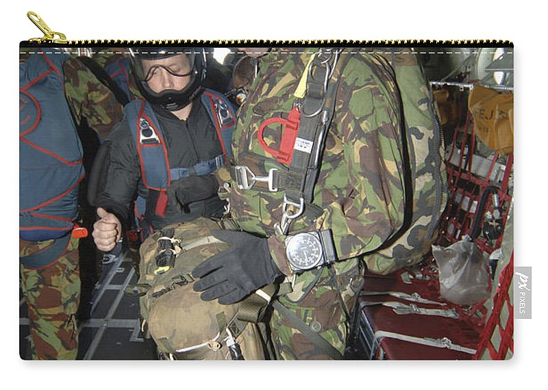 British Army Carry-all Pouch featuring the photograph Members Of The Pathfinder Platoon Wait by Andrew Chittock