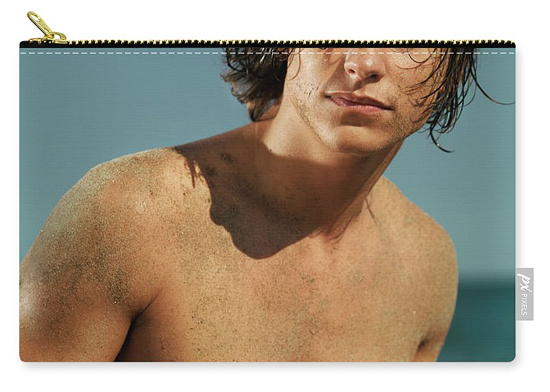 Man Carry-all Pouch featuring the photograph Portrait Of A Young Man On A Sea Shore by Oleksiy Maksymenko