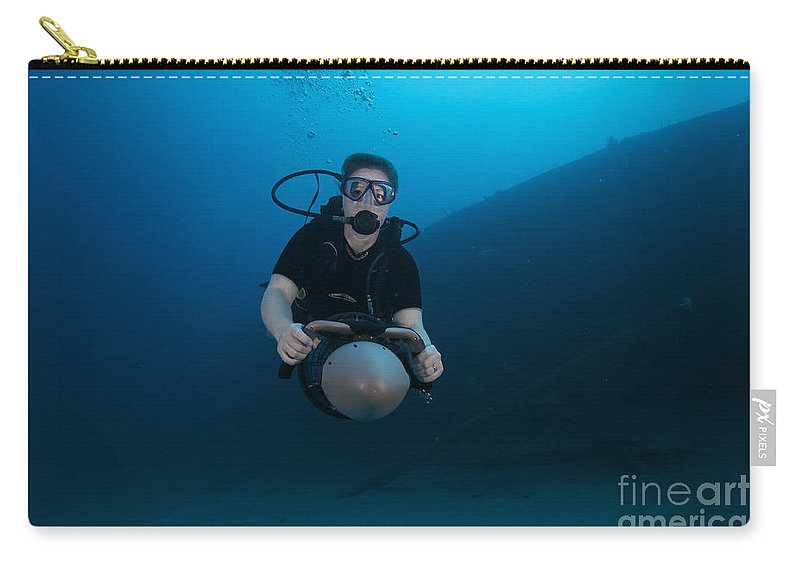 Bonaire Carry-all Pouch featuring the photograph Scuba Diver Uses A Diver Propulsion by Terry Moore