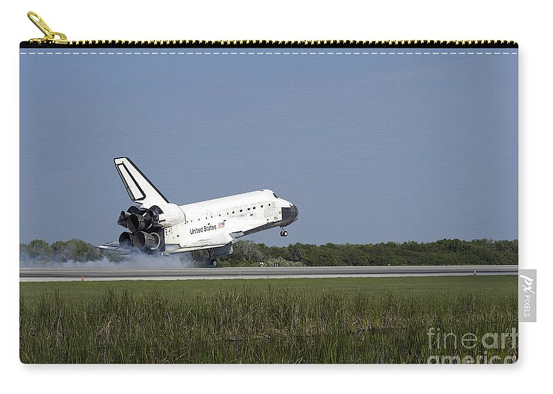 Sts-131 Carry-all Pouch featuring the photograph Space Shuttle Discovery Lands On Runway by Stocktrek Images